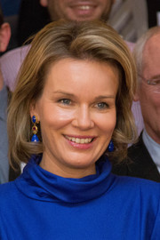 Queen Mathilde of Belgium sported a classic and elegant bob while visiting La Fondation contre le Cancer.