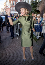 Queen Maxima graced the opening of 'A Royal Paradise' exhibition wearing a shimmery olive-green sheath dress.
