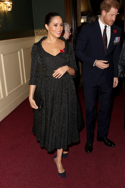 Meghan Markle kept it classic in a black jacquard dress by Erdem at the Royal British Legion Festival of Remembrance.