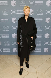 Tilda Swinton was her usual cool, sharp self in an embroidered, dual-textured black coat by Haider Ackermann at the 'Okja' screening during Qumra 2018.