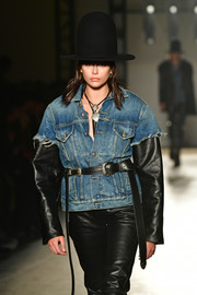 Kaia Gerber accessorized with a double-buckle leather belt at the R13 runway show.