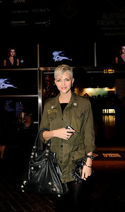 "Ruby Rose showed off the coveted ""City bag"" while attending Australian fashion week. She paired her shoulder bag with an army green button up."