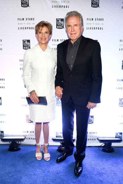 Annette Bening matched her dress with white broad-strap sandals.