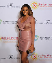 Ciara accessorizes her red carpet look with a metallic tube clutch.