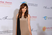 Actress Michelle Monaghan arrives at REACH: 24 Portraits by Randall Slavin Benefitting The Charlize Theron Africa Outreach Project at The Annenberg Space for Photography on October 12, 2011 in Los Angeles, California.