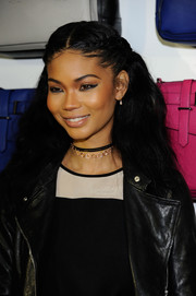 Chanel Iman opted for a half-up style with a center part and braided sides when she attended the Reed x Kohl's Collection launch.