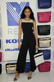 Chanel Iman ditched her usual sexy clothes for this tame black and nude wide-leg jumpsuit for the Reed x Kohl's Collection launch.