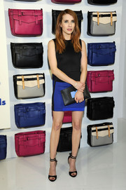 Emma Roberts coordinated her dress with a blue and black clutch by Reed x Kohl's.