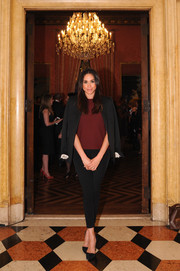 Meghan Markle opted for casual black skinnies and a burgundy sweater when she attended the Relais & Chateaux anniversary event.
