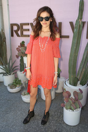 Camilla Belle went for boho cuteness in a smocked red off-the-shoulder dress by Tory Burch at the Revolve Desert House event.