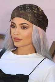Kylie Jenner stopped by the Revolve Desert House wearing a Louis Vuitton monogram head scarf.