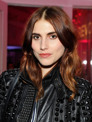 Langley Fox Hemingway styled her locks with a center part and billowy waves for the Revolve Pop-Up launch.