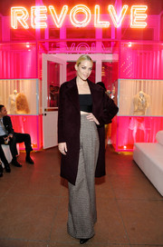 Jaime King was urban-chic in a burgundy coat layered over a sexy crop-top, both by Alexander Wang, during the Revolve Pop-Up launch.