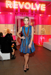 Ashley Benson attended the Revolve Pop-Up launch wearing a color-block, fit-and-flare print dress.