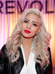 Amy Pham topped off her look with a popping red pout.