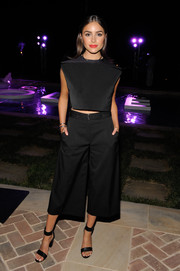 Black ankle-cuff sandals tied Olivia Culpo's look together.