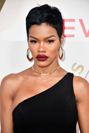 Teyana Taylor played up her full lips with matte red lipstick.