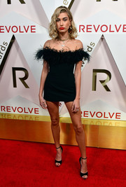 Hailey Baldwin put on a leggy display in a feathered off-the-shoulder LBD by LPA at the #REVOLVEawards.