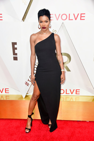 Teyana Taylor kept it minimal yet sophisticated in a figure-hugging black one-shoulder gown by NBD at the #REVOLVEawards.