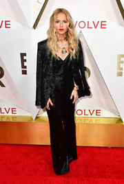 Rachel Zoe attended the #REVOLVEawards wearing a sparkly black jumpsuit and a matching jacket from her own line.