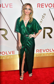 Nicole Richie donned a metallic green wrap gown by House of Harlow 1960 for the #REVOLVEawards.