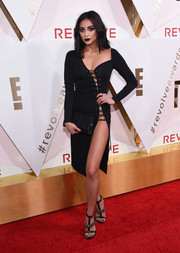 Shay Mitchell grabbed stares in a body-con black lace-up dress by H:ours at the #REVOLVEawards.
