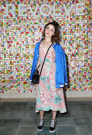 Natalia Dyer added a sporty touch with a blue track jacket.