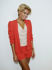 Sylvie van der Vaart looked stunning in a bright coral blazer that looked great against her bronzed skin.