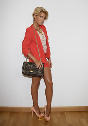 Sylvie van der Vaart posed carrying an amazing beaded shoulder bag with a gold chain strap.