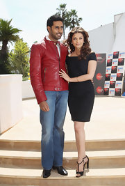 Abhishek Bachchan went for a sporty look with faded jeans and a red leather jacket at the 'Raavan' photocall.