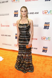 Peta Murgatroyd coordinated her dress with a studded gold clutch by Tod's.