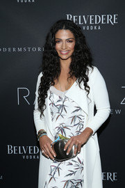 Camila Alves carried a metallic bird-motif clutch to go with her foliage-print dress at the Rachel Zoe presentation.