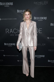 Whitney Port amped up the shine with a beaded silver clutch.