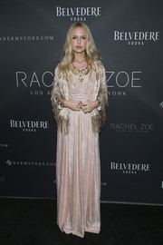 Rachel Zoe polished off her looked with a fringed gold jacket.