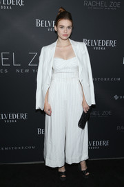 Holland Roden looked effortlessly stylish in a white pinstriped jacket, pants, and bustier ensemble at the Rachel Zoe presentation.