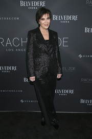 Kris Jenner suited up in this sequined black jacket and trousers combo by Rachel Zoe for the brand's Fall 2018 presentation.
