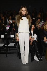 Olivia Palermo stuck to a classic black and white sweater paired with crisp white pants for Rachel Zoe's Fall 2013 runway show.
