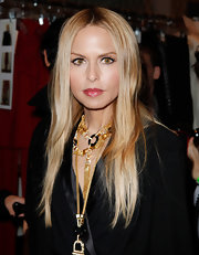 Rachel Zoe wore her hair sleek and straight with a simple center part at her fall 2012 fashion presentation.