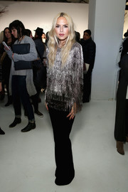 Rachel Zoe looked party-ready in a silver fringe top from her own label while presenting her latest collection.