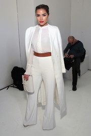 Olivia Culpo donned a demure white ruffle blouse by Rachel Zoe for the label's presentation.