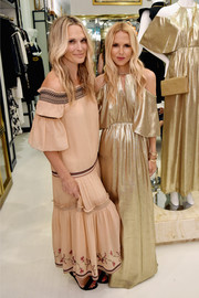 Molly Sims went for some boho flair with this nude off-the-shoulder maxi dress at the Rachel Zoe x What Goes Around Comes Around pop-in.