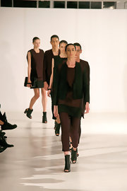 Erin O'Connor walked down the runway at the Rad By Rad Hourani fashion show during Mercedes-Benz Spring 2013 Fashion Week in a pair of black peep-toe ankle boots.