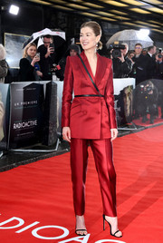 Rosamund Pike looked sharp in a crimson pantsuit with black leather detailing at the UK premiere of 'Radioactive.'
