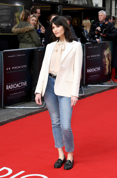 Gemma Arterton layered a white blazer over a blush pussybow blouse for the UK premiere of 'Radioactive.'