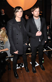 Jared is wearing a black wool pea coat with his all black ensemble to this fashionable event.