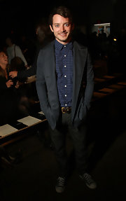 Elijah Wood attended the Rag & Bone fashion show wearing a casual men's suit.