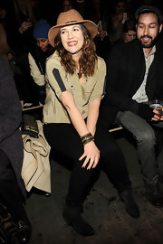 Drew Barrymore showed her hippie style with a tan, sparkly walker hat at the Rag & Bone runway show.