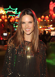 Alessandra Ambrosio wore her long and lustrous hair loose and casual at the Rage Offical launch party. To get her super shiny look mist on a product like Fekkai Glossing Sheer Shine Mist.