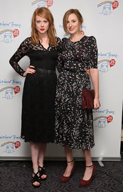Laura Carmichael went vintage at the Silver Jubilee Ball as she teamed up her floral dress with a brown leather purse.