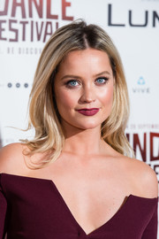 Laura Whitmore swiped on some berry lipstick to match her outfit.